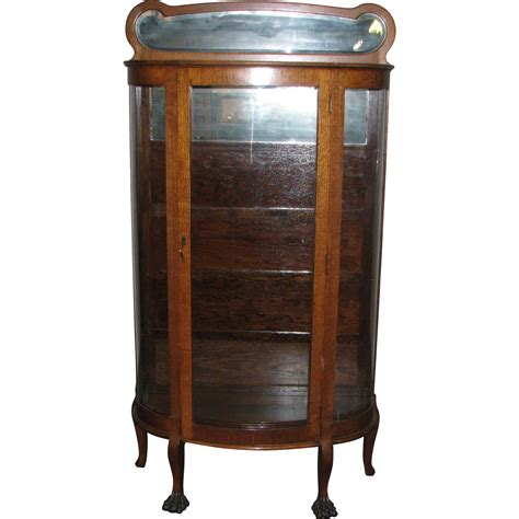 oak china cabinet with curved glass front