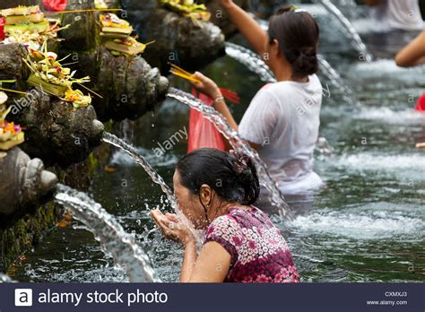 a ritual washing in the basins of the hindu temple stock photo royalty free image