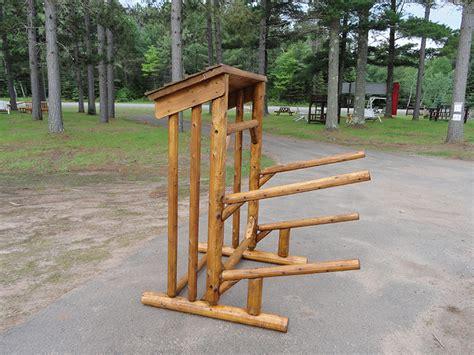 Place Rack by 2 Place Log Kayak Rack With Storage Log Firewood Rack