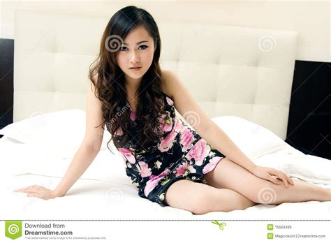 girl sitting on bed beautiful girl sitting in bed stock photos image 15563493