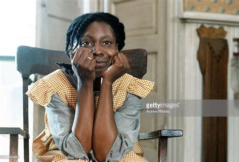 whoopi goldberg color purple whoopi goldberg sitting in a chair with on