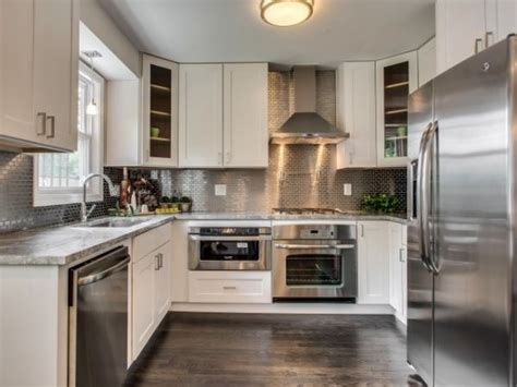 dark island w cream colored cabinets silver hardware silver kitchens ideas inspiration