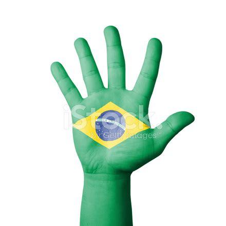 design by humans brasil open hand raised brazil flag painted stock photos