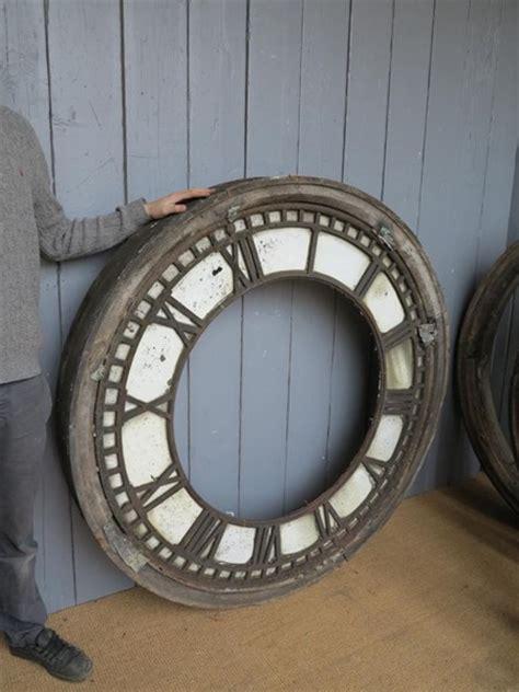 antique cast iron clock faces  wooden frames