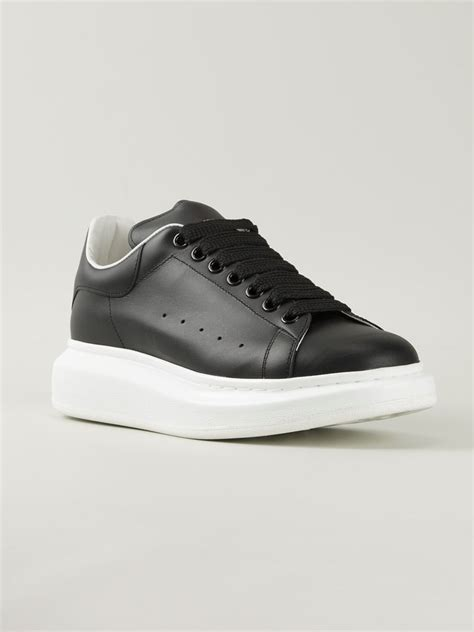mcqueen mens sneakers mcqueen extended sole low top sneakers in black