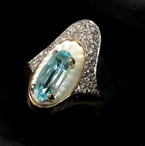 erte quot alouette quot ring with blue topaz diamonds in 14k