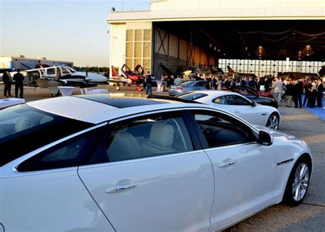 exotic cars lined out of the blue jet show the voice tribune
