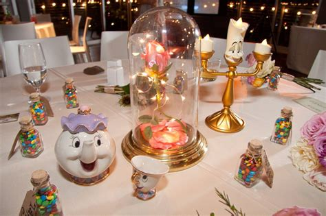 wedding reception with disney themed guest tables simplemost