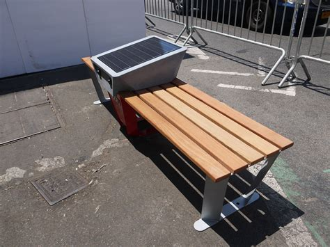 solar bench soofa s solar bench lets people charge electronics on city