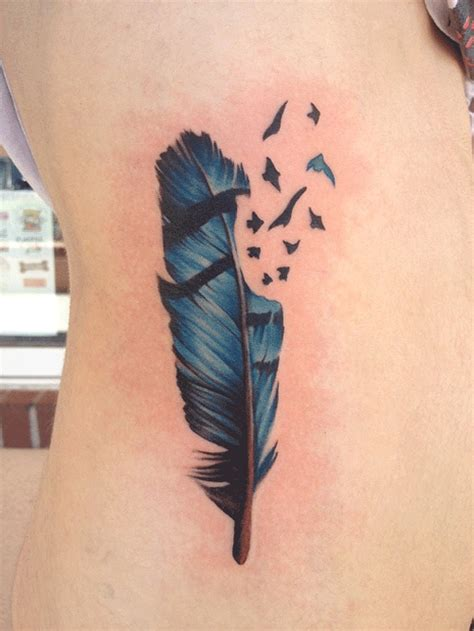 feather with birds tattoo meaning 40 mind blowing feather tattoos creativefan