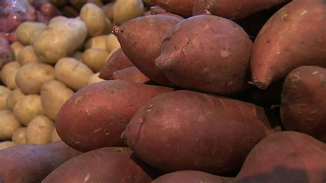 Shelf Of Sweet Potatoes by What S The Difference Between A Sweet Potato And Yam