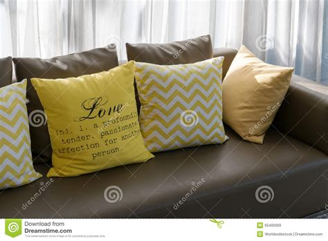 brown yellow pillows living room design with brown sofa and yellow pillows