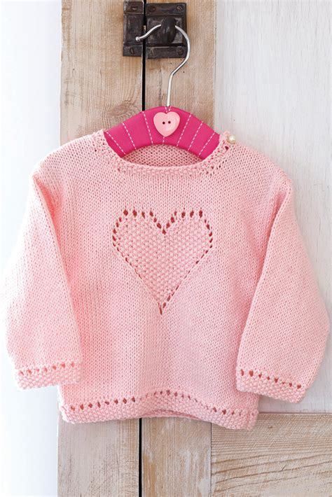 knitting pattern jumper with heart knitted pink sweater for little girls with heart design on