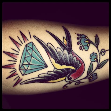 traditional diamond tattoo sparrow with and traditional flower done by ben
