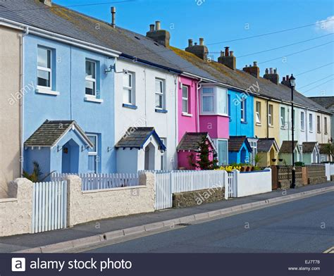 buy house in devon terraced of brightly coloured houses in westward ho devon england stock photo