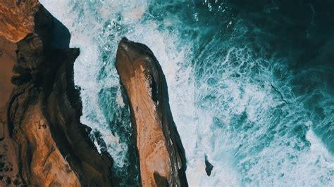 splashing body  water  rock formation  image
