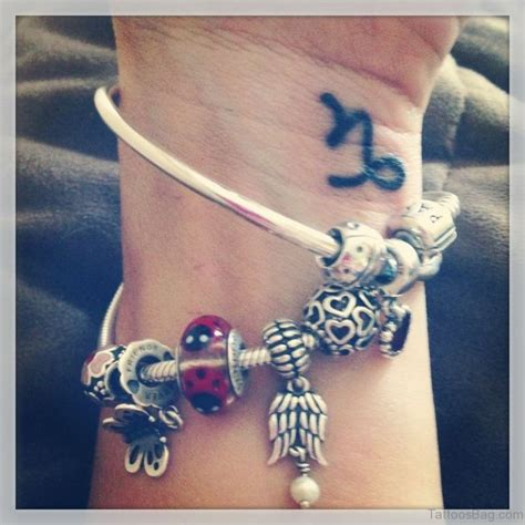 capricorn tattoos for wrist 15 capricorn wrist tattoos