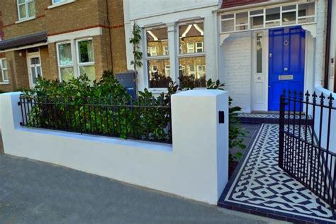 Terraced Backyard Landscaping Ideas Clapham Brick Wall And Metal Rails Landscape Garden