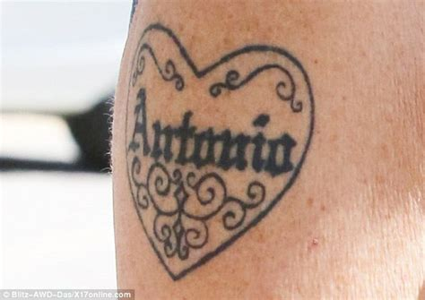 melanie griffith covers up antonio tattoo while daily