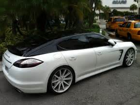 white black porsche panamera with painted roof