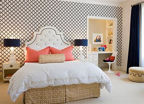 white bedding with accent pillows decorating with shades of coral