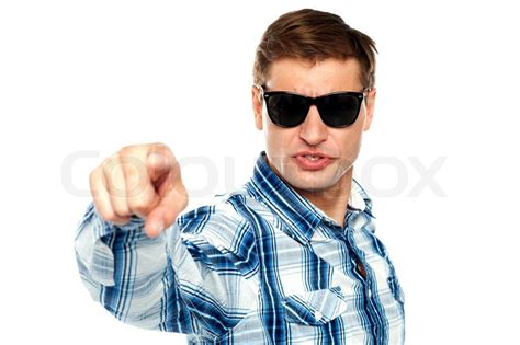 cool stock cool fashionable guy pointing at you stock photo colourbox
