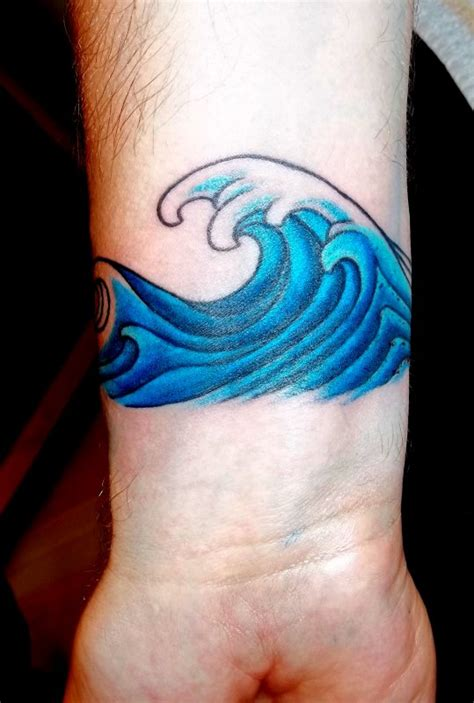 tribal wave tattoo on wrist
