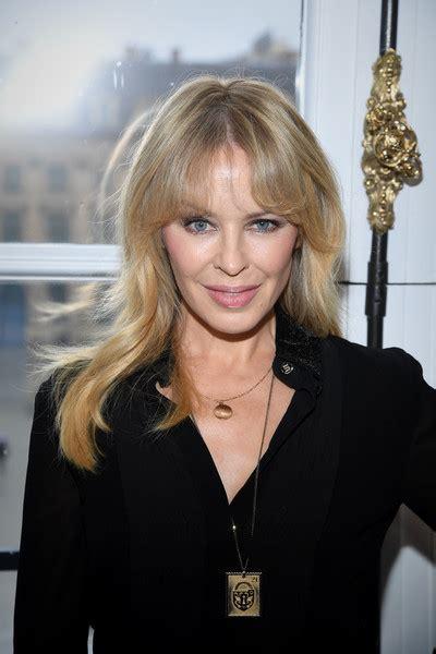 Minogue Hairstyles minogue wavy cut with bangs hair lookbook