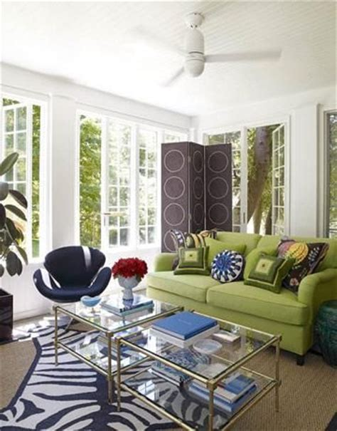green sofa living room zebra rugs french windows and glass top coffee table on