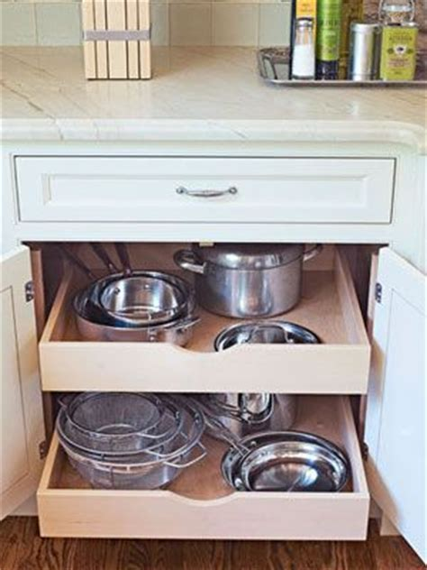 Pull Out Drawers For Pots And Pans by A Cabinet With Pull Out Shelves And Extension Glides Puts Pots And Pans Within Reach Of The