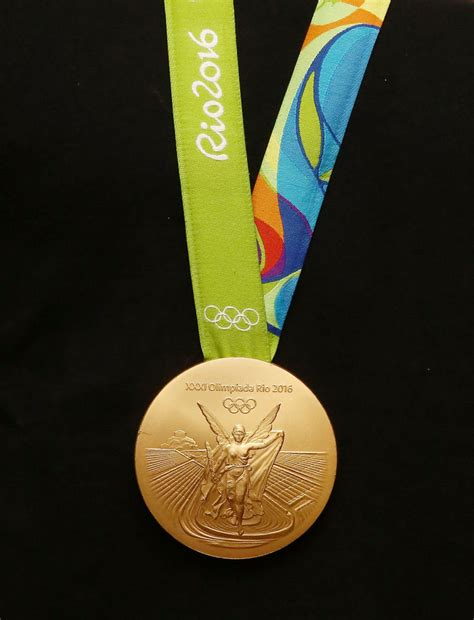 How Much Money Does Olympic Gold Medalist Win - image gallery olympic gold medal
