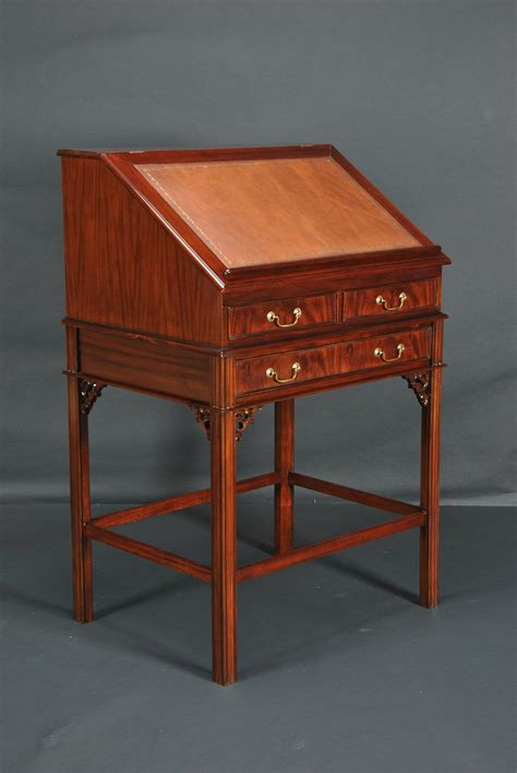 leather top stand up mahogany desk with interior drawers