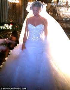 pink gets into her wedding dress again but this time