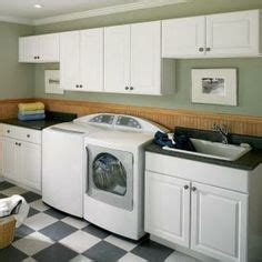 white wall cabinet laundry room creative laundry makeover maximization for better look
