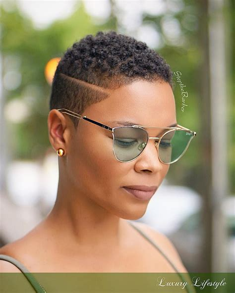 Tapered haircut with a disconnected side part twa black woman short natural haircuts
