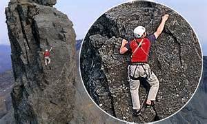 conquering   pin intrepid climber reaches  summit