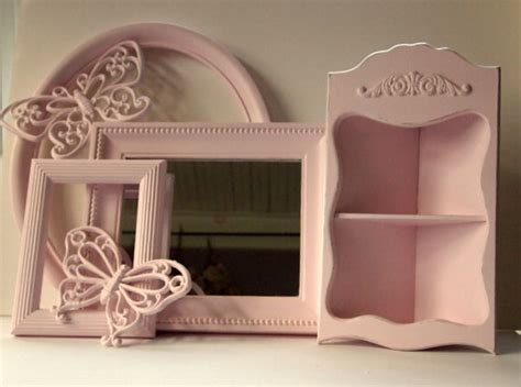 picture frames mirror corner shelf and butterflies wall
