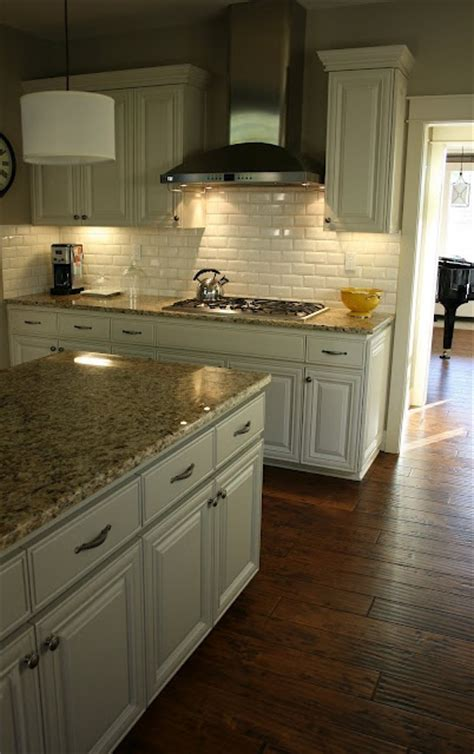 antique white kitchen with wood floors and an island sink 127 best kitchen decor images on pinterest home ideas