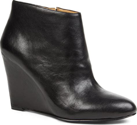 nine west nine west riguma wedge boots in black lyst