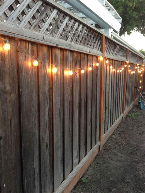 how to hang string lights on fence 31 best garden fence decoration ideas and designs for 2018