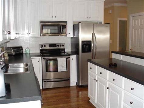 Black And White Kitchen With Stainless Steel Appliances White Kitchen Cabinets With Stainless Steel Appliances