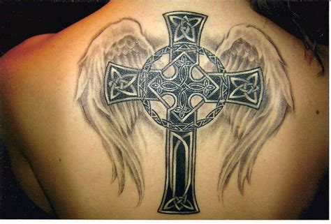 a celtic cross tattoo with angel wings celebrates both