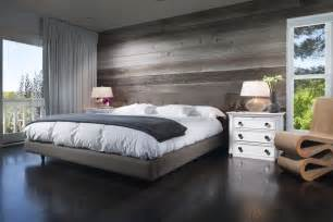 contemporary master bedroom with reclaimed wood plank wall