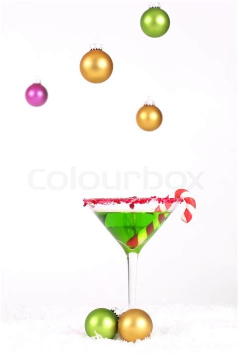 holiday cocktails background christmas drink and hanging coloured baubles decoration on