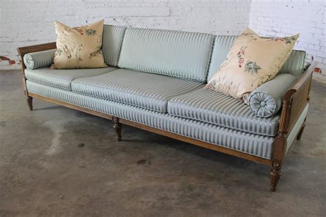 hollywood regency sofa vintage hollywood regency neoclassic sofa with caned sides