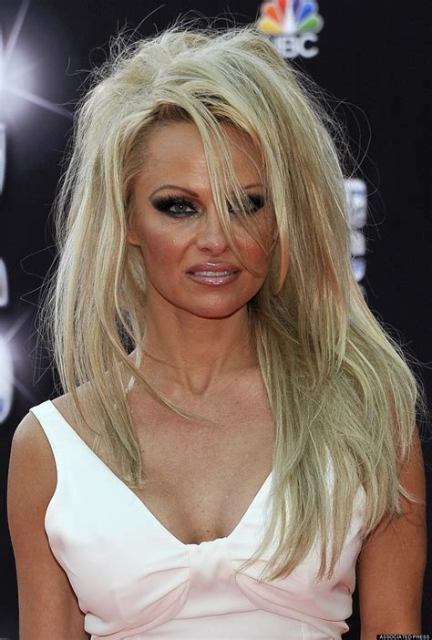 pamela anderson ditches pixie cut for long hair extensions