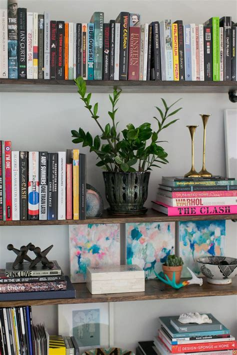 25 best ideas about organizing bookshelves on
