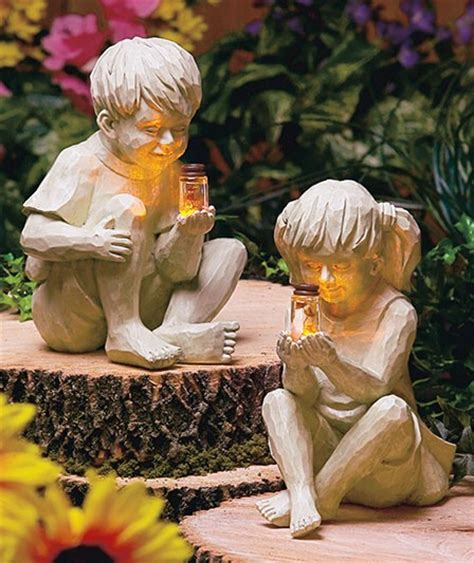 Solar Garden Statues by Boy Or Children With Solar Fireflies Lighted