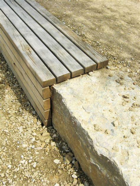realisation d'un muret en pierre et banc en bois dans un