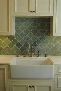 cabinets brass hardware green arabesque tile